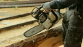 Man cuts off beam chainsaw for future home 23649227