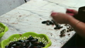 Woman Cleans Mussels in the Fish Market 23876136