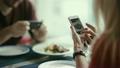 woman, smartphone, sitting 23896345