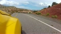 Yellow car driving winding road - time lapse 23904873