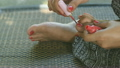 painted toenails with red nail polish. 23931057