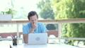 Yawning Tired Designer at Work, Sitting Outdoor 24650954