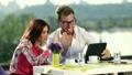 Confident businessman talking online using tablet 25042421