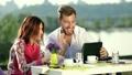 Businesspeople having online meeting using tablet 25042510
