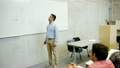 students and teacher at white board on lecture 25252938