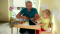 Father with smart phone and toddler girl playing 25402131