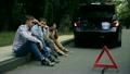 young men sit on roadside car is broken down 25672257