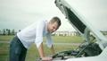 Man looking at engine of car. man repairing broken 25864314