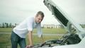 Man looking at engine of car. man repairing broken 25864737