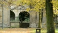 Old historical gateway in the autumn park. Zoom ou 26054763