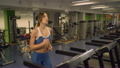 Adult lady running on cardio machines in gym. 26136106