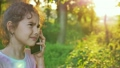 teen girl talking on the phone on a green 26282200