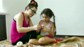 Mother and daughter engaged in knitting girl and 26282227