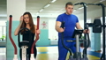 girl in a gym, and a man is tired simulator sport 26282230