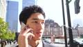 ビジネスマン スマホ 話す 東京駅前 大手町 丸の内 ビジネス街 外 1人 26457274