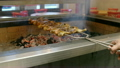 cooking chicken on the grill 26560856
