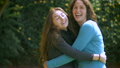Two girl friends hug, smile and laugh in slowmo 26693095