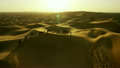 Aerial drone of a convoy of camels with owners across desert sand 26751848
