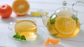 Glass teapot and Cup with green tea, orange 27597161