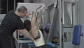 Young man and woman relaxing and exercising at the 27710358