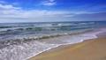Coast beach with sea waves. Sunny paradise resort. 27883371