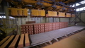 Conveyor belt assembling bricks. 28049150