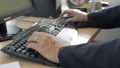 Men's hands typing on a keyboard 28080281