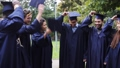 happy students throwing mortar boards up 28537768