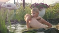 Two happy brothers swimming in a pool in summer 28701329