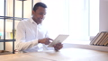 Man Using Tablet in Office 29279322