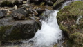 Water stream flowing in the mountain range footage 29361186