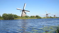 Windmills in Netherlands with water flowing agains 29361194