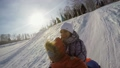 Happy mum and son are sledding in the mountain 29367598