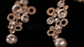 Close up video of bracelet and earrings in jewelry 29444639
