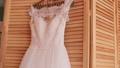 Beautiful luxurious wedding dress on hanger on 29444648