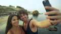 Beautiful young couple taking selfies on the beach 29444724
