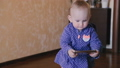 Funny baby plays with mobile phone 29577161