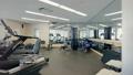 Simulators in large gym, condo apartment 29586997