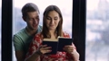 Sweet young couple reading a book together at home 29632444