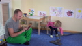 Father with tablet and cute girl hoover floor with 29938324