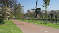 Bicyclist with windmill in The Netherlands 30258202