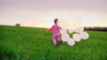 Little girl in pink clothes with balloons. I play 30409195