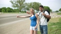 hitchhiking, woman, man 30574173