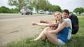 hitchhiking, woman, man 30574185