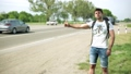 hitchhiking, man, roadside 30781382