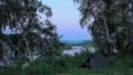 Tourist tents. Sunset, Spring flood in the river 30828490