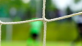 Soccer game seen through net, blurred view 31069133