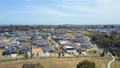 Aerial video houses in a suburb 31104902