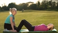 Lady doing abdominal crunches exercise on mat 31345946