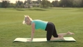 Attractive adult woman practicing yoga in park 31345962